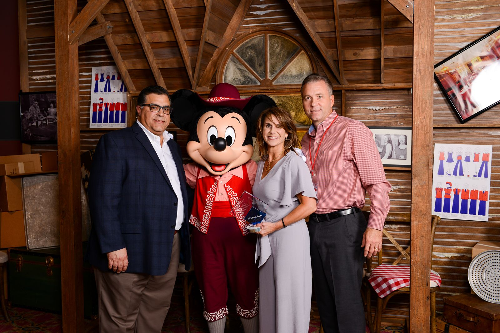 Pizza Inn President, Bob Bafundo with CaraBeth and Michael Moore, Franchisee of the Year.
