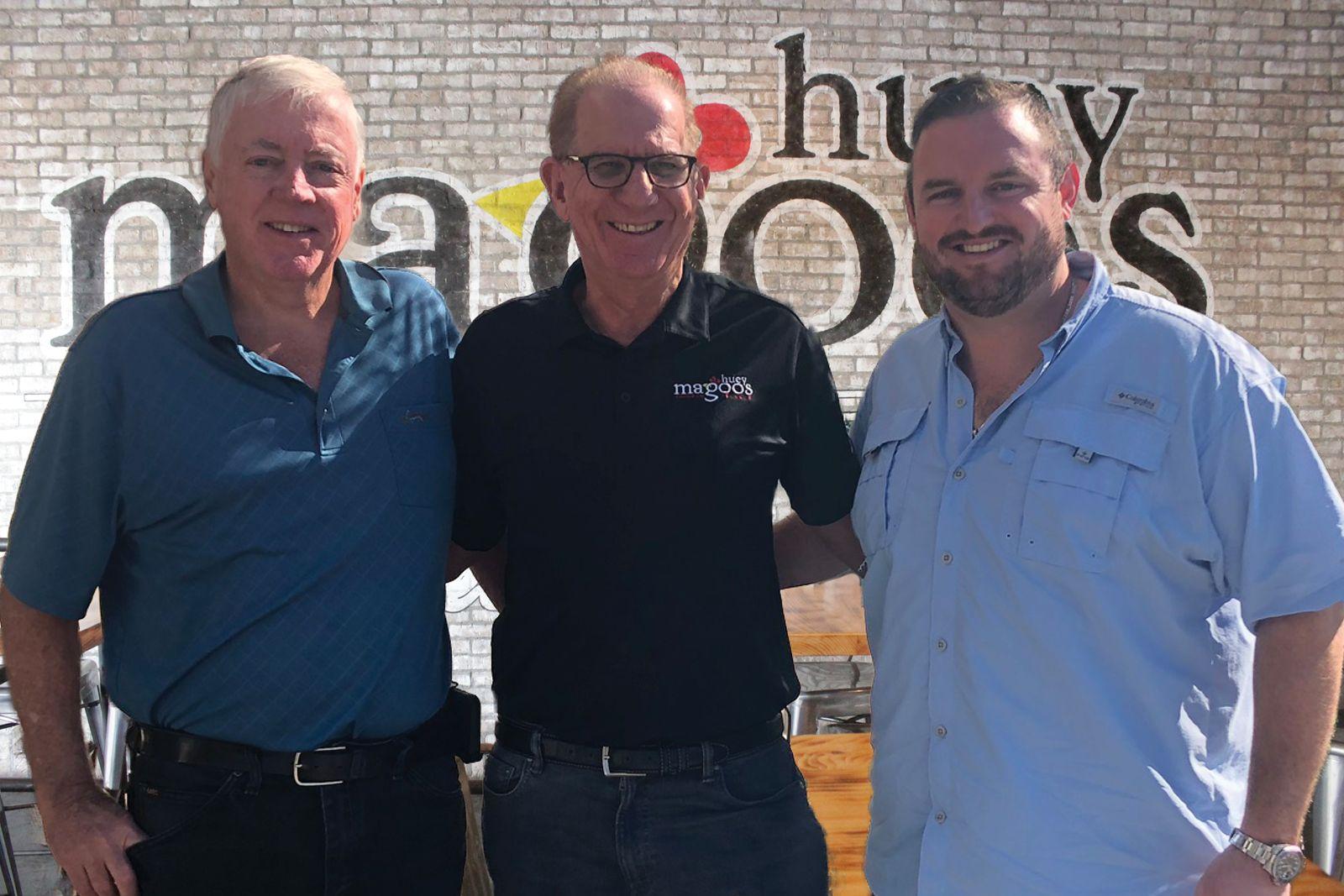 Huey Magoo's Bob Cafferty, CEO Andy Howard and Tyler Cafferty.