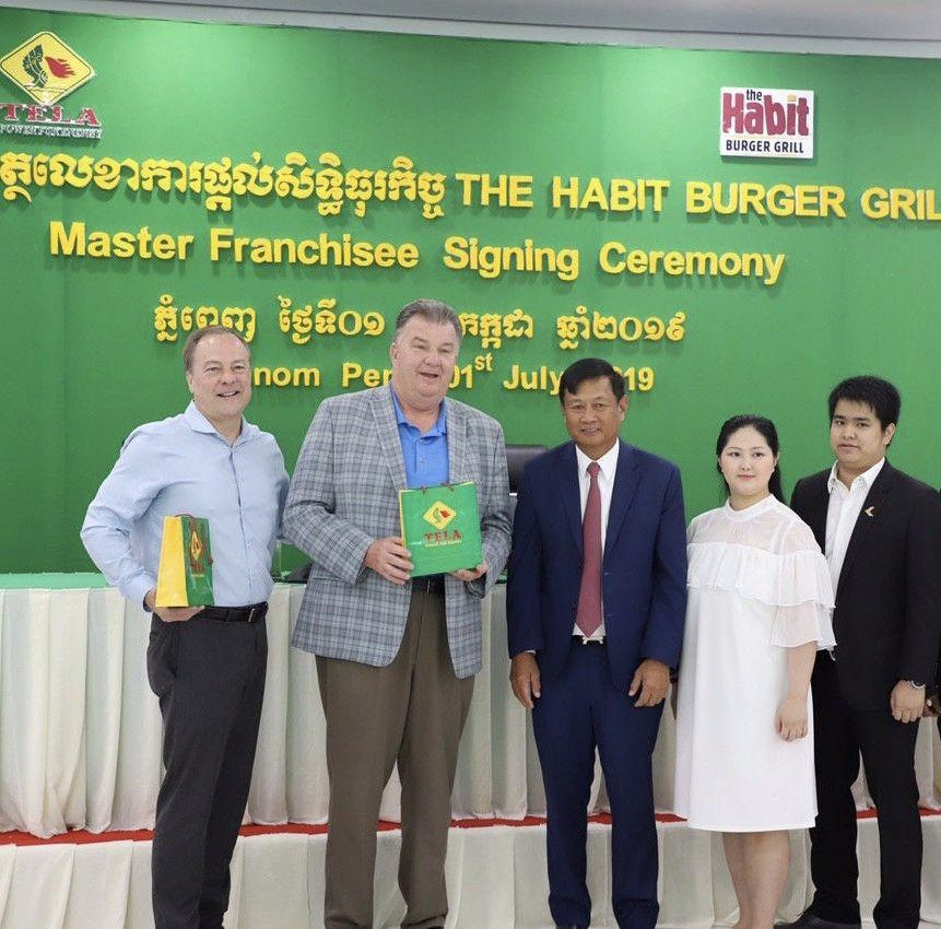Pictured: John Phillips, Russ Bendel, OKHNA Chhun On, Chief Executive Officer of Kampuchea Tela Company, Madam Chhun Sophearoth, CEO of Amory F&B Company, Mr. Vireakdara Soun, President of Amory F&B Company.