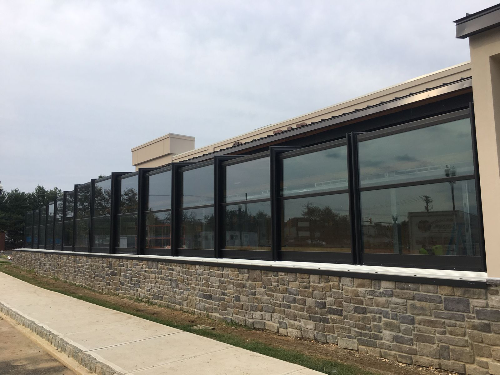 Cinder Bar's Roll-A-Cover Retractable Patio Enclosure Opening Soon