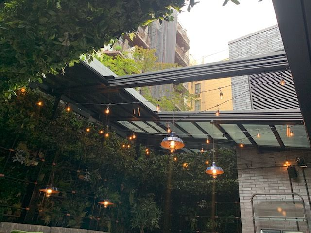 Roll-A-Cover's Retractable Enclosures Transform the Outdoor Spaces at Moxy East Village