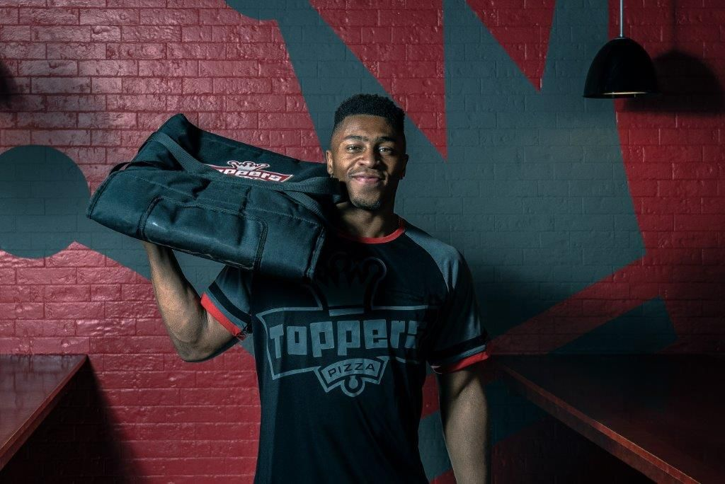 University of Wisconsin Running Back and NFL Hopeful Jonathan Taylor Tackles Next Venture as Franchisee of Toppers Pizza